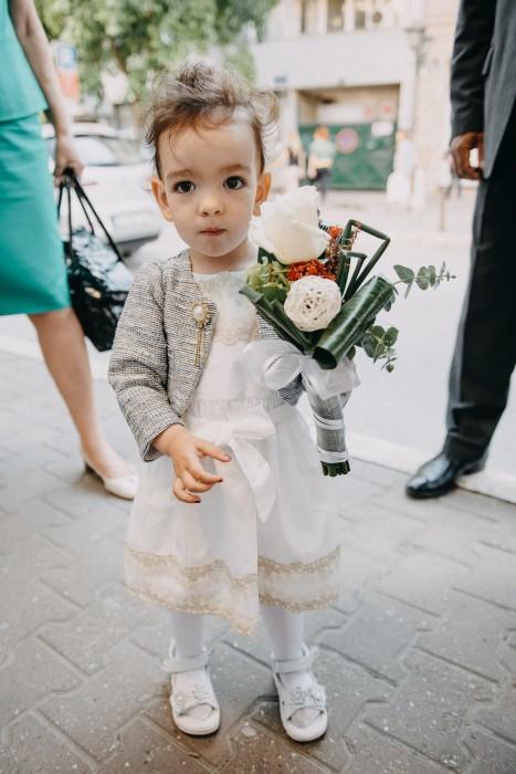 Little girl holding a bouquet