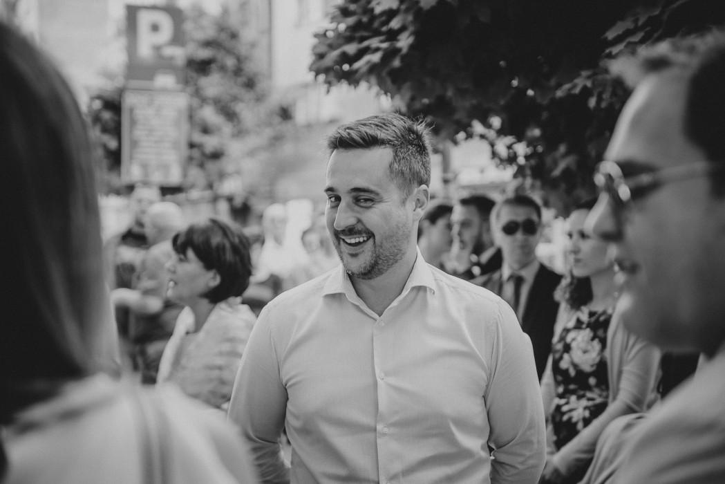 Man smiling in Zeleznicka street in Novi Sad