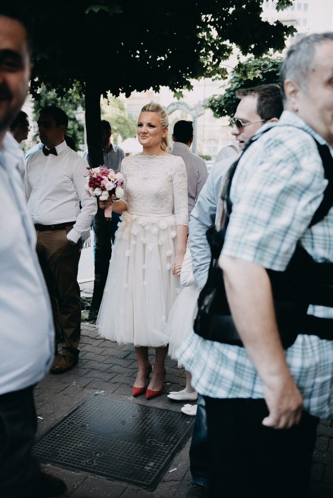 Bride standing on a sidewalk in Novi Sad
