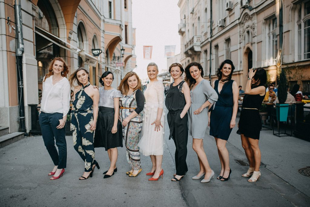 Bride posing with bridesmaids in Novi Sad town center