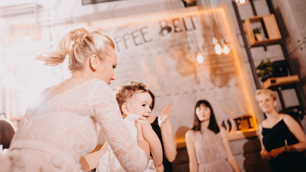 Bride holding a baby girl and dancing in Loft Lounge and Bar Novi Sad
