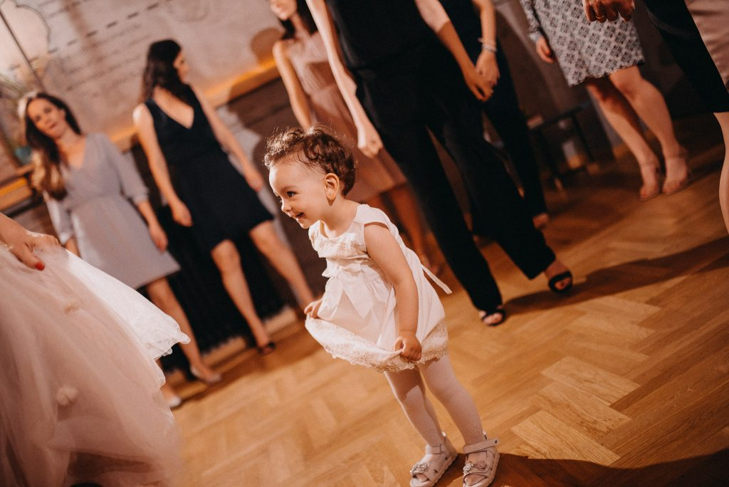 Little bridesmaid dancing beside bride in Loft Lounge and Bar Novi Sad