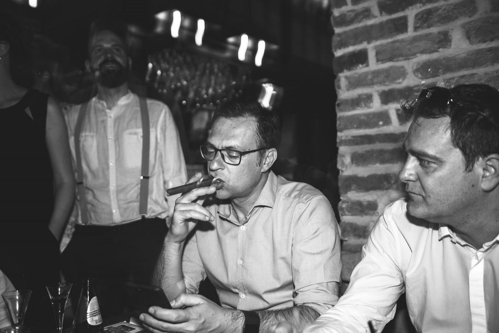 Man smoking cigar in loft lounge and bar novi sad