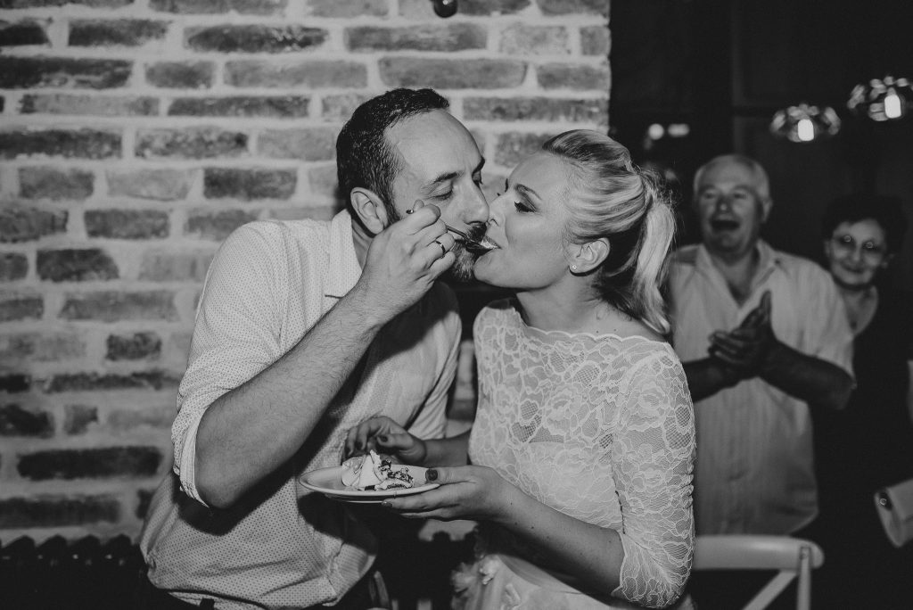Bride and Groom eating cake in Loft Lounge and Bar Novi Sad