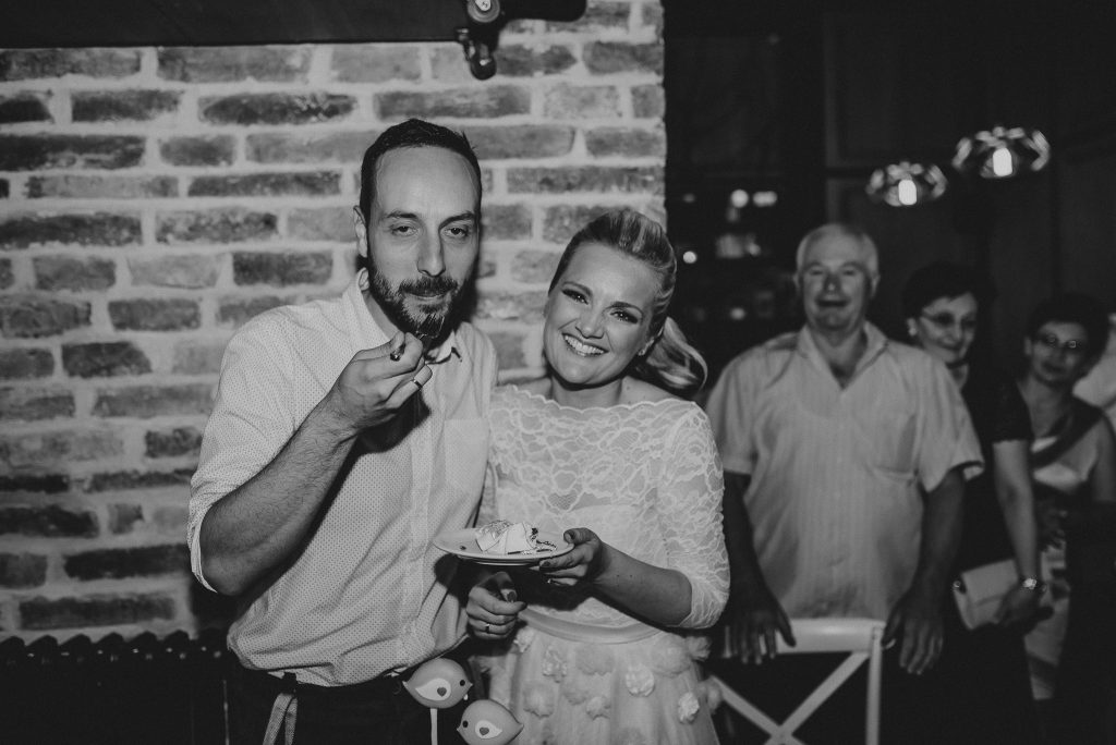 Bride and Groom eating wedding cake in Loft Lounge and Bar Novi Sad