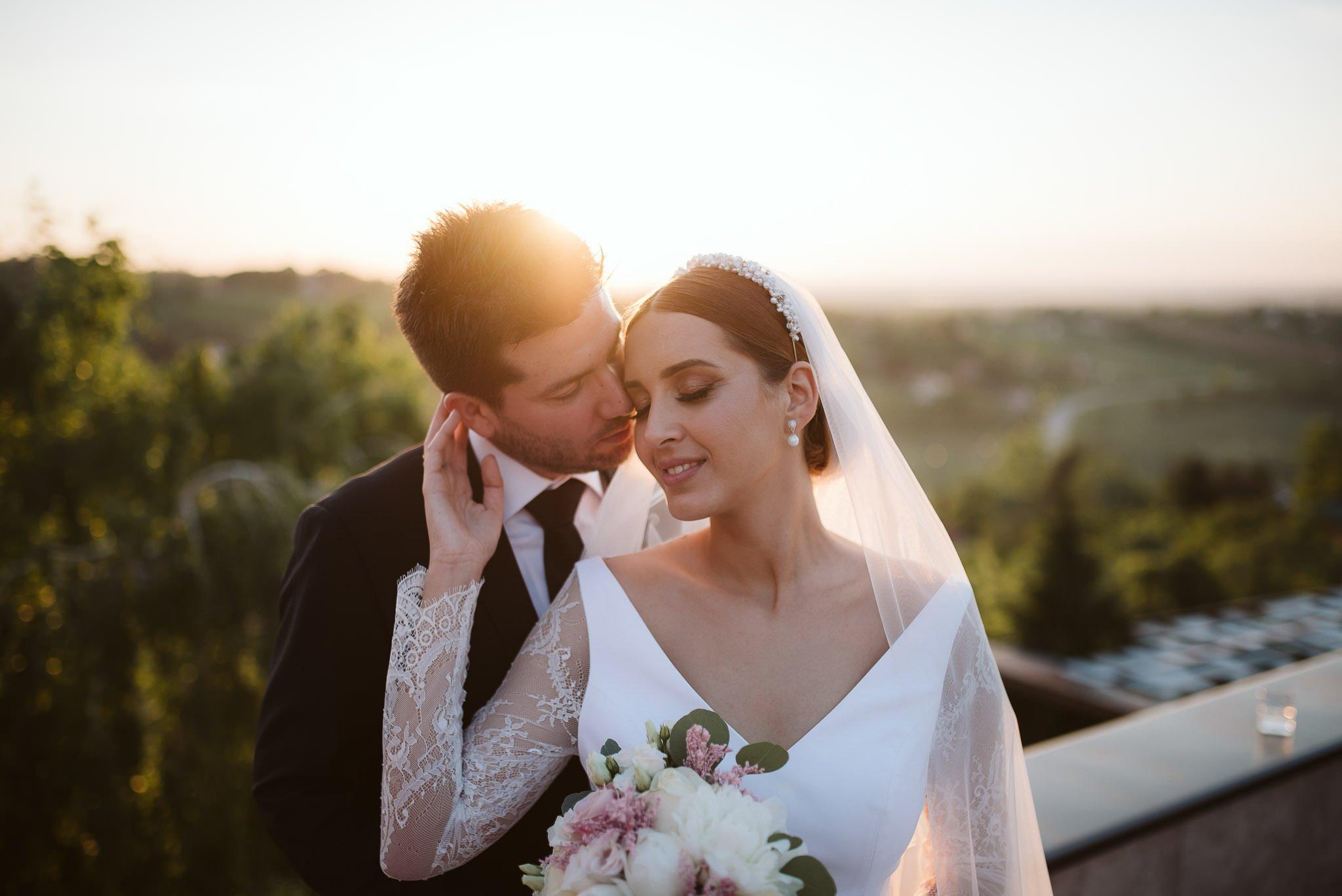 Bride posing next to an old church Petrovaradin, Novi Sad, Serbia